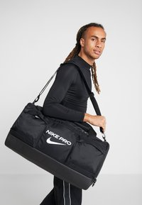 Nike Performance - POWER M DUFF PRO - Sports bag - black/white - 1