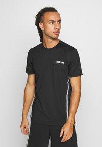 adidas Performance - MIX TEE - Print T-shirt - black/white - 0