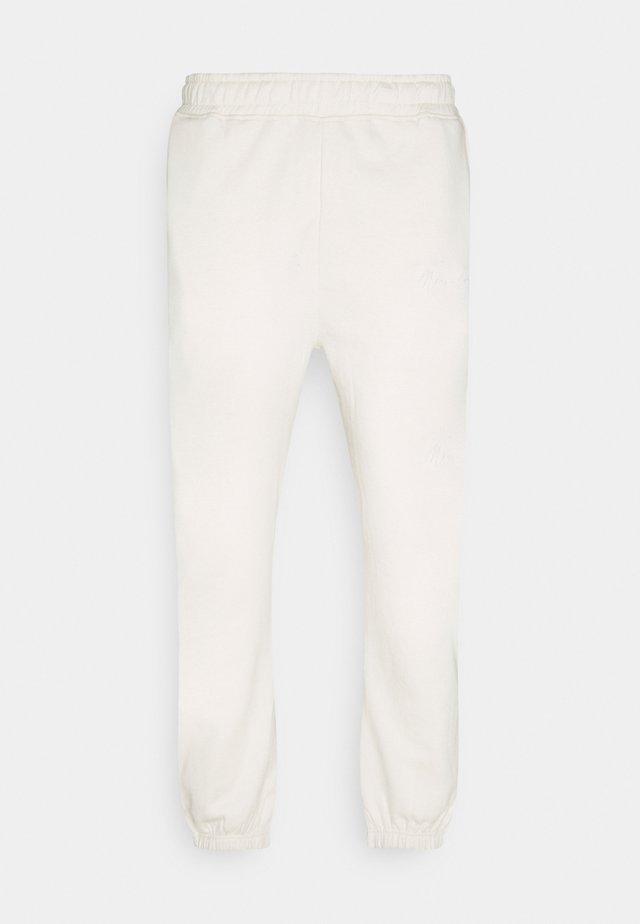 ESSENTIAL UNISEX - Teplákové kalhoty - sand