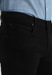 Lee - TRENTON - Straight leg jeans - black rinse - 4