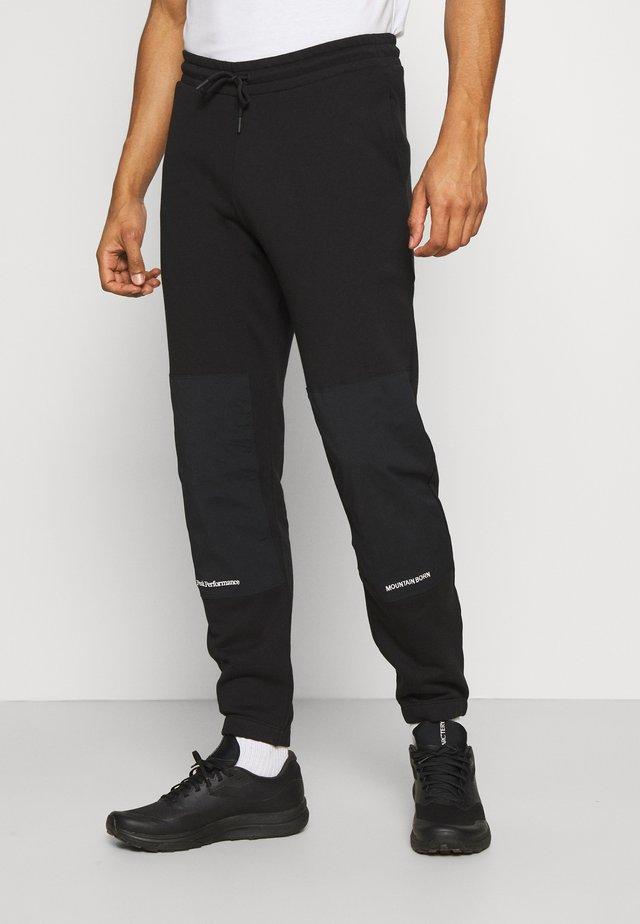 STOWAWAY PANT - Teplákové kalhoty - black