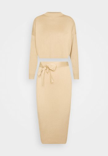 FUNNEL NECK CROPPED JUMPER AND TIE WAIST MIDI SKIRT SET