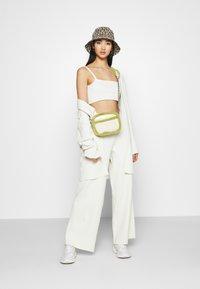 NA-KD - NA-KD X ZALANDO EXCLUSIVE SOFT RIBBED PANTS - Kalhoty - offwhite - 1