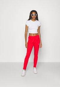 adidas Originals - PANTS - Joggebukse - red - 1