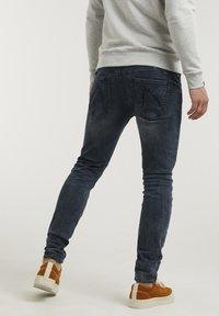 CHASIN' - NEW RAVEN - Slim fit jeans - dark blue - 1