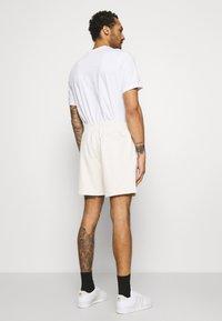 adidas Originals - PREMIUM UNISEX UNISEX - Tracksuit bottoms - offwhite - 2