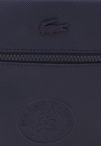 Lacoste Sport - VERTICAL CAMERA BAG - Across body bag - marine - 4