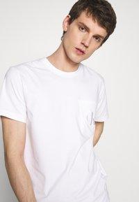 Calvin Klein Jeans - TONAL POCKET MONOGRAM TEE - Print T-shirt - bright white - 3