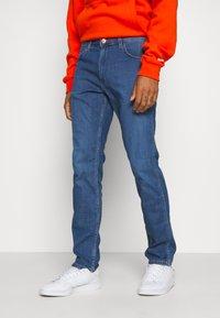 Wrangler Greensboro Regular Fit Mens Jeans Limelite Blue