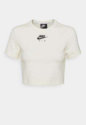 AIR CROP - Print T-shirt - coconut milk/black