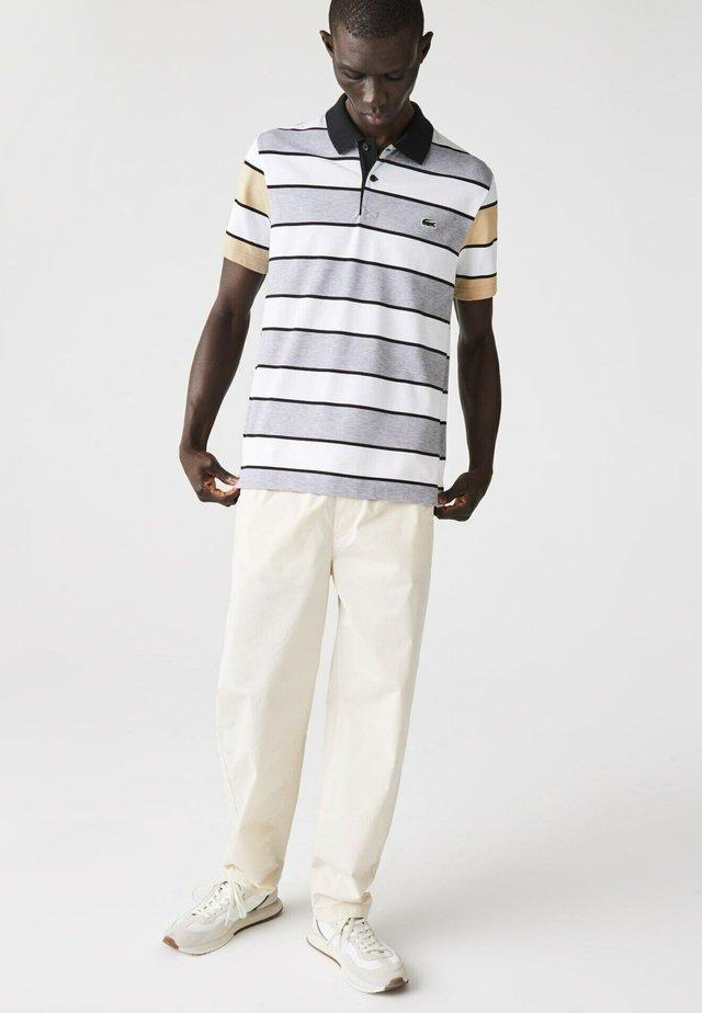Polo - heidekraut grau / weiß / beige / schwarz