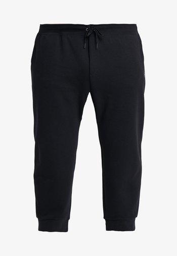 DOUBLE KNIT TECH - Tracksuit bottoms - polo black