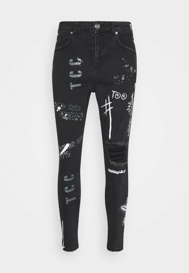GRAFITTI CARROT FIT - Jeans Tapered Fit - black wash