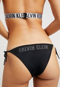 Calvin Klein Swimwear - INTENSE POWER CHEEKY STRING SIDE TIE - Bikini bottoms - black - 5