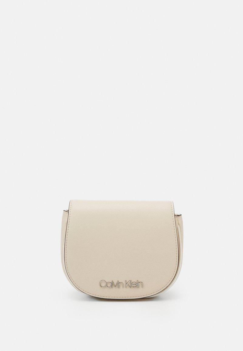 Calvin Klein - CHAIN BELT BAG - Bum bag - beige