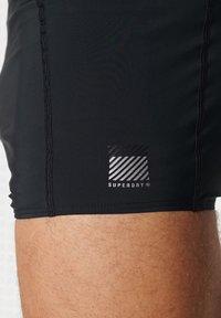 Superdry - Swimming shorts - black - 2