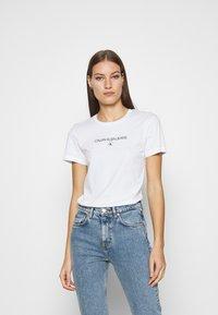 Calvin Klein Jeans - ROUND TEE - Print T-shirt - white - 0