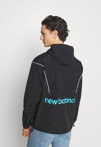 New Balance - ATHLETICS WINDBREAKER - Summer jacket - black - 2