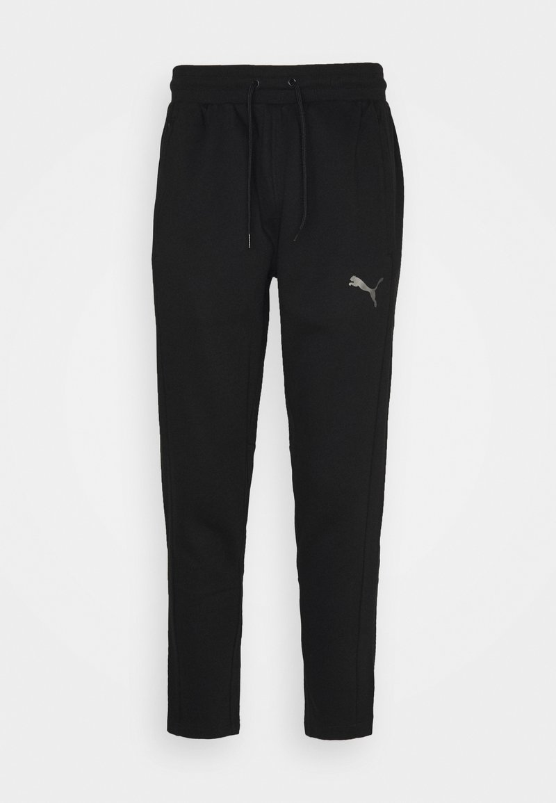 Puma - TRAIN TAPERED PANT - Pantalones deportivos - puma black