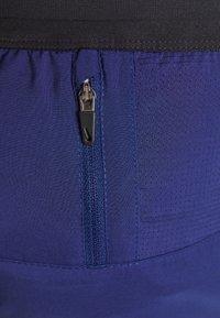 Nike Performance - STRIDE SHORT - Sports shorts - blue void/white - 5
