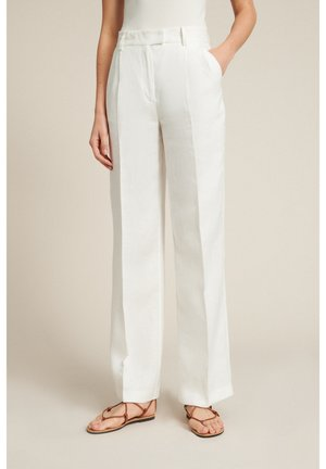 AMOUR - Trousers - panna