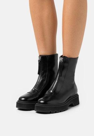 STINT FRONT ZIP BOOT - Platform ankle boots - black