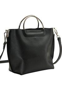usha - Handbag - black - 2