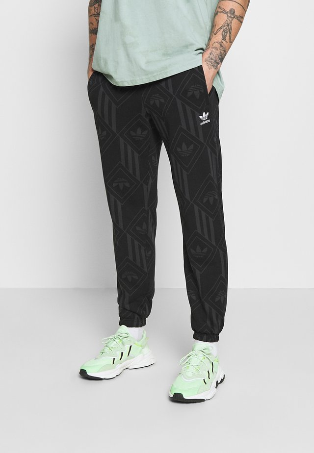 MONO - Pantalon de survêtement - black/boonix