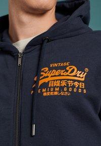 Superdry - VINTAGE LOGO EMBOSSED - Zip-up hoodie - atlantic navy - 2