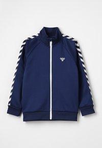 Hummel - HMLKICK - Training jacket - black iris - 0