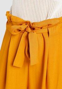 khujo - EIVOLA - Trousers - yellow - 4