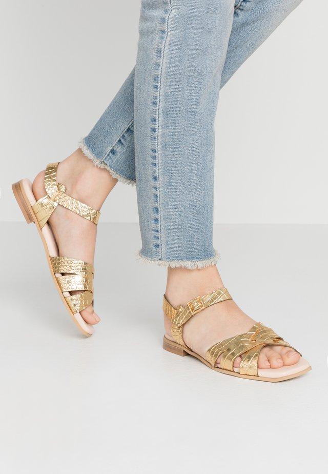 Sandalen - oro