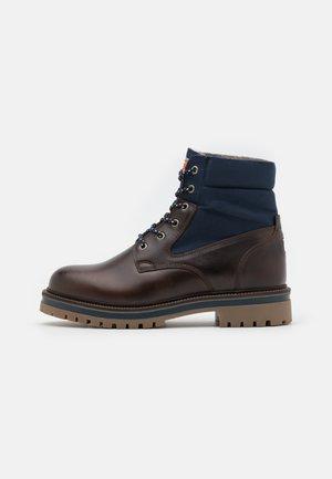 PALMONT - Winter boots - dark brown/marine