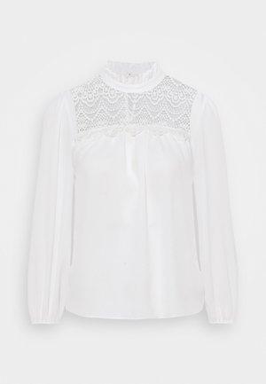 RUFFLE NECK YOKE - Button-down blouse - ivory