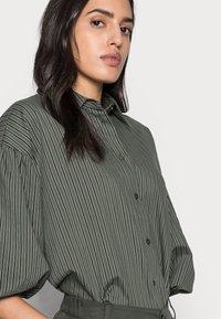 InWear - YOKO SHIRT - Button-down blouse - beetle green - 3