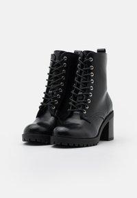 mtng - MAYA - Šněrovací kotníkové boty - black - 2