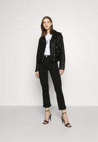 ONLY - ONLRAIN SWEET - Flared Jeans - black - 1