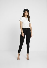 ONLY Petite - ONLEVIE  ANKLE  PIPING - Leggings - Trousers - black - 1