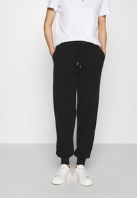Johnstons of Elgin - CUFFED JOGGERS - Tracksuit bottoms - black - 0