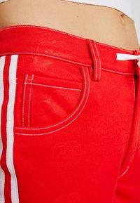 adidas Originals - TRACKPANT - Jogginghose - red - 5