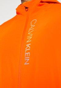 Calvin Klein Performance - PRIDE WINDJACKET - Trainingsvest - danger orange - 4