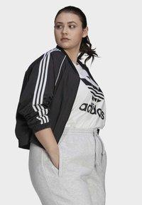 adidas Originals - SHORT TT - Training jacket - black - 2