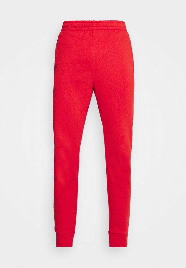 Lacoste Spodnie treningowe - redcurrant bush/czerwony Odzież Męska JZTN