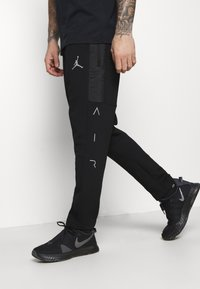 Jordan - AIR PANT - Tracksuit bottoms - black/white - 3