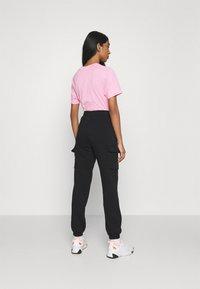 Nike Sportswear - PANT - Trainingsbroek - black/black/white - 2