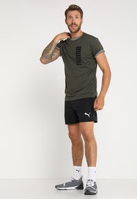 Puma - ACTIVE SHORT - Sports shorts - black - 1