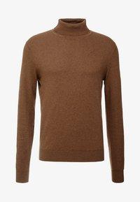 Stickad tröja - mottled brown