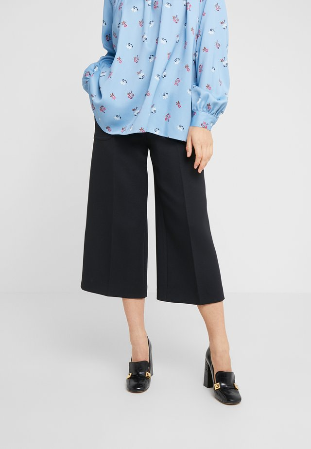 VIVIAN - Trousers - black