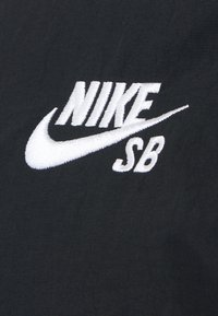 Nike SB - ESSENTIAL JACKET UNISEX - Kevyt takki - black/white - 2