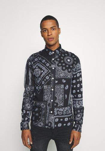 KELVIN - Shirt - black